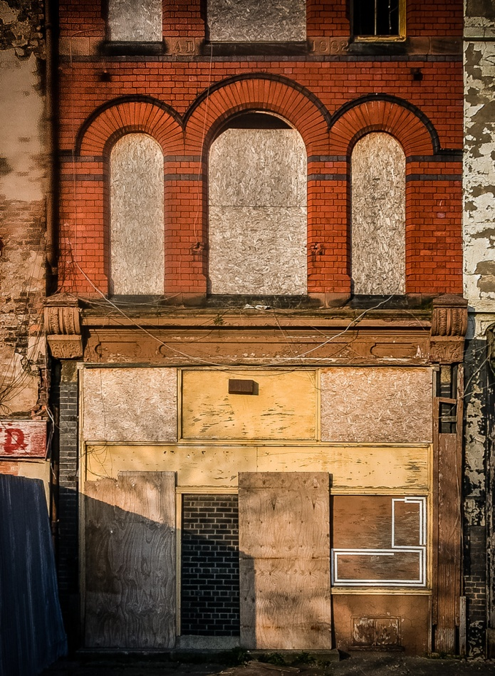 Nameless boarded up shop
